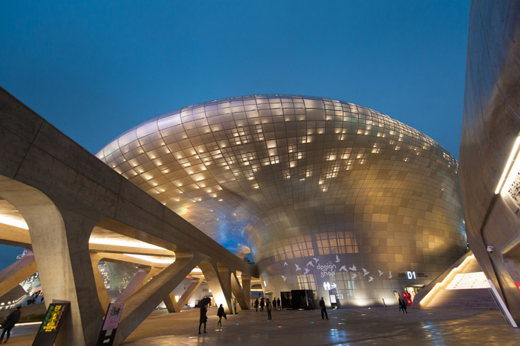 This magnificent structure is Dongdaemun Culture & History Park, a modern cultural space built on an ancient site. It hosts Seoul fashion week, millennia old relics housed in museums, and shops & galleries filled with products from independent Korean designers.