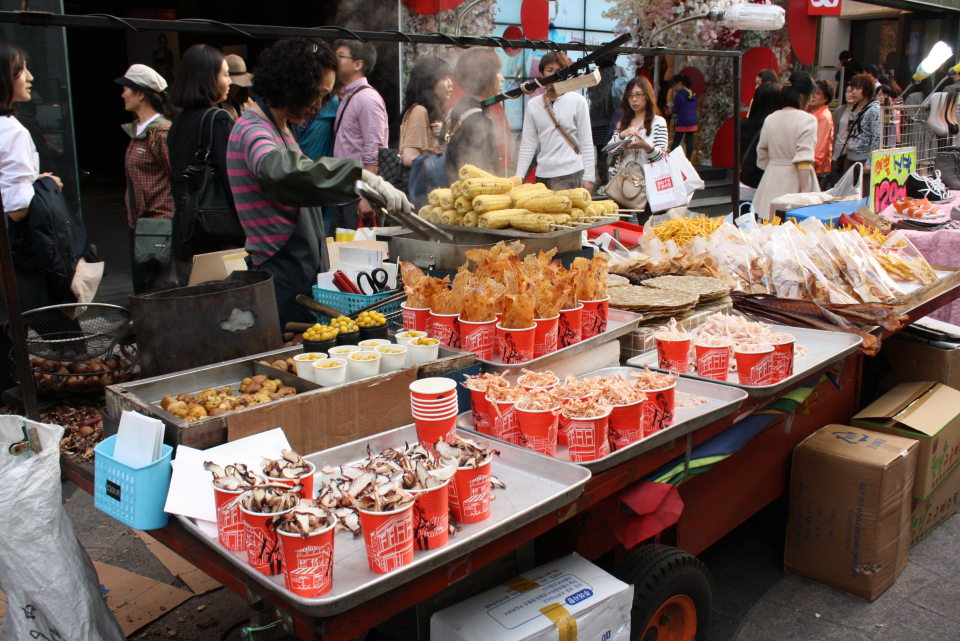 It's also known for its street food. Stall after stall you'll find unique and interesting street foods that cannot be found elsewhere in Korea. (Photo Credit: dlitefulcravings)