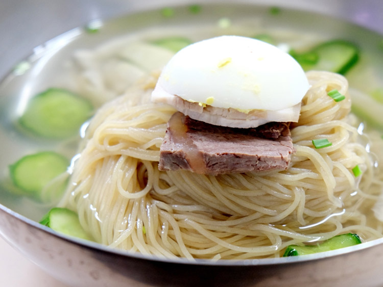 Dongdaemun is an old part of Seoul that has some of the oldest and most famous restaurants, including cold naengmyeon noodles (pictured - from Pyeongyang Myeonok), spicy trotter (jokbal), chicken stew (dalkhanmari), fried fish, Korean pancakes (bindaetteok).