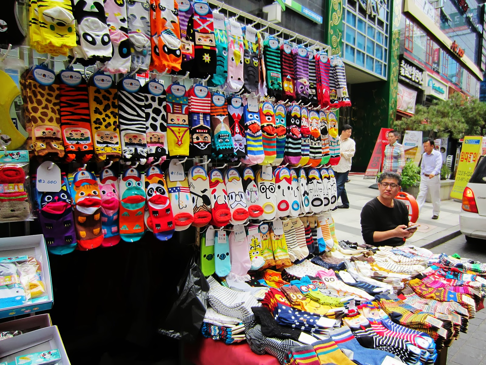 It's known for street shopping where you can buy cute trinkets, fashionable clothes, Kpop paraphernalia and lots of cute socks. (Photo credit: Touristonweekends)